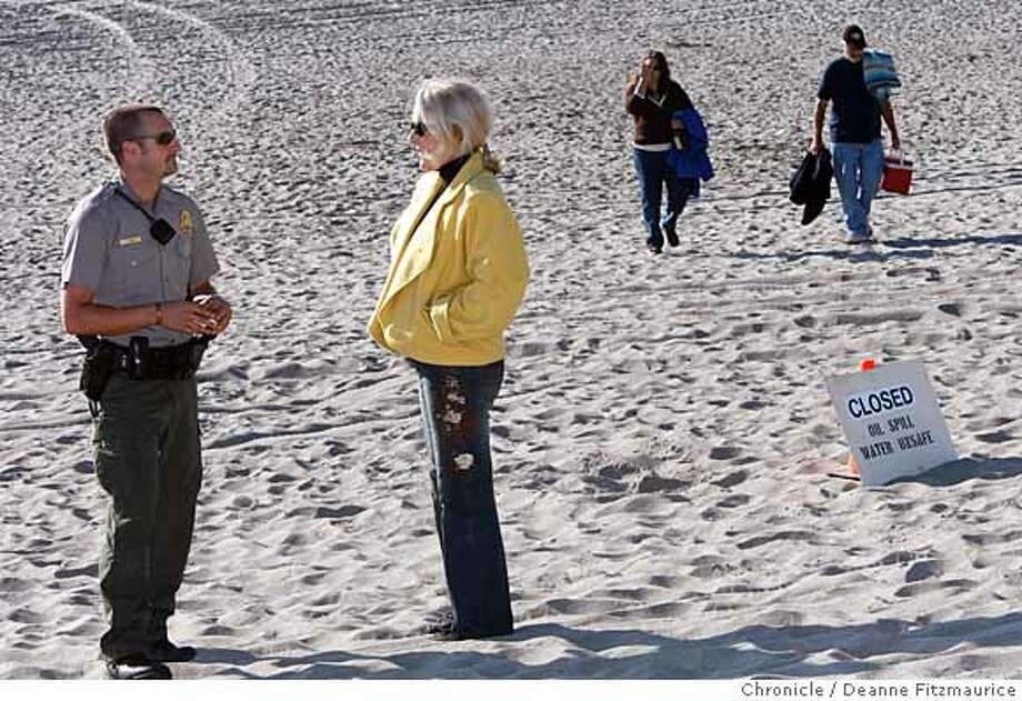 oilspill_123_df.jpg  Park Ranger, Chad Marin, with the National Park Service, at left, informs people they must leave the beach as it is closed. Stinson Beach was closed today as an oil slick moved toward the beach after Wednesday's oil spill in San Francisco Bay. Photographed in Stinson Beach on 11/9/07. Deanne Fitzmaurice / The Chronicle Ran on: 11-10-2007  National Park Service ranger Chad Marin (left) tells people that they must leave Stinson Beach.  Ran on: 11-10-2007 Photo: Deanne Fitzmaurice