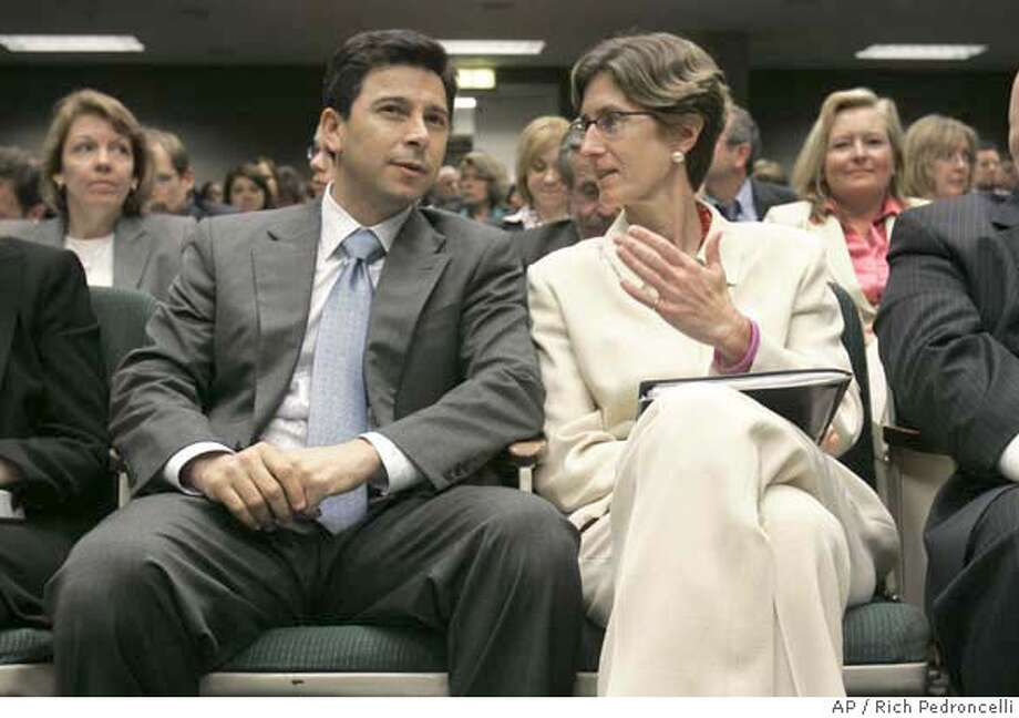 Kim Belshe, Secretary of the Health and Human Services Agency, right, talks with Assembly Speaker Fabian Nunez, D-Los Angeles, before their appearance at the Assembly Health Committee at the Capitol in Sacramento, Calif., Wednesday, October 31, 2007. The committee held a special session informational hearing to discuss Gov. Arnold Schwarzenegger's revised health care plan.(AP Photo/Rich Pedroncelli) Photo: Rich Pedroncelli