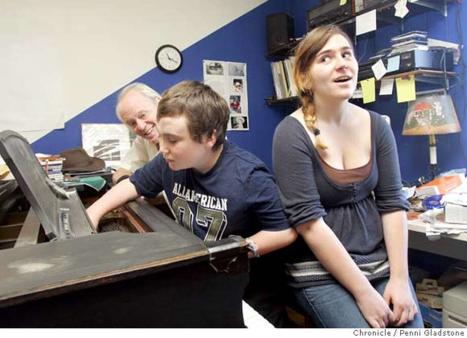 delone07_050_PG .JPG Austin de Lone's cramped music room at home. His son 9 year old Richard, center, checks out the inside of the piano while his sister 16 yr old Caroline, suddenly realizes what's happening.  Elvis Costello is doing a special benefit Nov. 8 playing his first album, with a reunited version of the band who backed him, Marin County's Clover. The benefit was arranged by local music scene stalwart Austin De Lone, a musician Elvis has known and admired and worked with for many years. DeLone's 9 year-old son, Richard, suffers from Prater-Willi syndrome, a disease that  leaves Richard always hungry. He is currently living in a group home but spends the weekends with his parents and 16 year-old sister, Caroline. Wife is Lesley. Event on 11/3/07 in Mill Valley.  Penni Gladstone / Must Credit Photo: Penni Gladstone