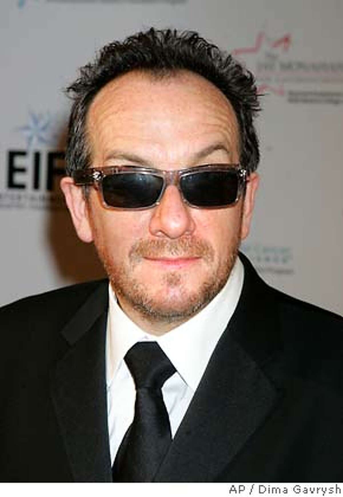 """Elvis Costello, attends the """"Hollywood Meets Motown"""" fundraiser, Wednesday, March 15, 2006, in New York. The event benefits EIFs National Colorectal Cancer Research Alliance and the Jay Monohan Center for Gastrointestinal Health at New York-Presbyterian Hospital / Weill Cornell Medical Center, named in honor of Katie Courics late husband, who lost a nine-month battle with colon cancer in 1998, at the age of 42. (AP Photo/Dima Gavrysh)Ran on: 03-24-2006 Josh Ritter comes to Great American Music Hall June 7."""