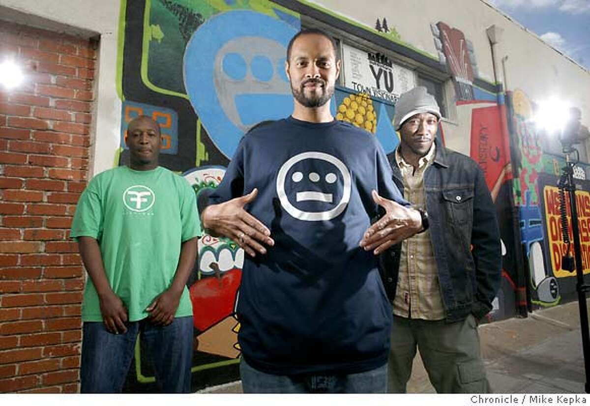 Flanked by recording artists Pep Love (left) and Prince Ali (rt), Tajai Massey, 32, is the leader of Hiero Imperium, in Oakland, Calif. which has become one of the most successful, longest-running indie labels in the Bay Area. Aside from recording and album production, the Hieroglyphics collective has launched a successful t-shirt and hoodie line and are soon to add jeans to the mix. Mike Kepka / The Chronicle Photo taken on 10/9/07, in Oakland, CA, USA