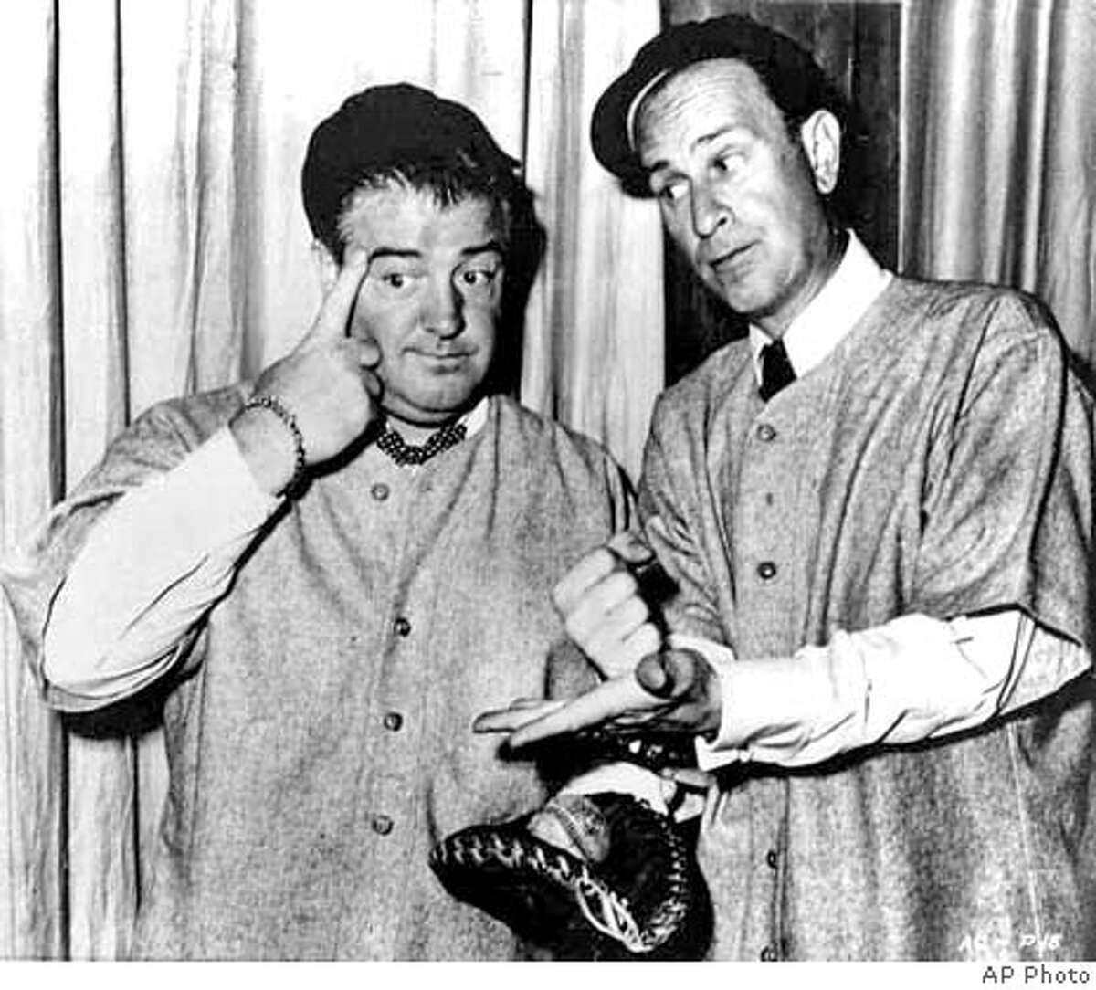 Bud Abbott, right, and his partner Lou Costello, do their famous baseball sketch in an undated photo. They were best remembered for their zany
