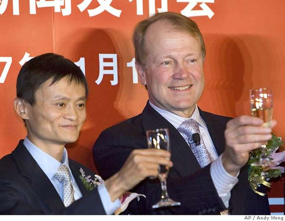 Cisco Chief Executive John Chambers, right, toasts a champagne with Jack Ma, chairman and CEO of Alibaba Group after witnessing a joint ventures partnership signing agreement at a hotel in Beijing, China, Thursday, Nov. 1, 2007. Network gear maker Cisco Systems Inc. on Thursday announced a multi-year, US$16 billion (euro11.1 billion) series of initiatives to expand in China with investments in manufacturing, venture capital and education efforts. Chambers said the ventures include a partnership with Alibaba Group, China's biggest online commerce company, to develop business services for small and medium-sized companies. (AP Photo/Andy Wong)  Ran on: 11-02-2007  Cisco CEO John Chambers toasts to the growing relationship with Jack Ma, chairman and CEO of Alibaba. Photo: Andy Wong