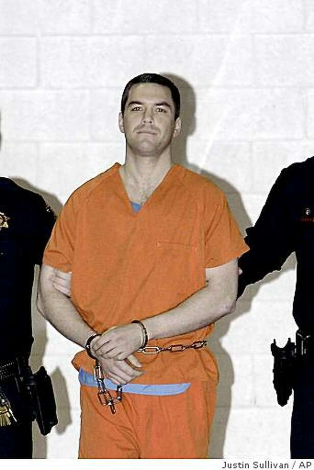** FILE ** In this file photo from Thursday, March 17, 2005, Scott Peterson is escorted by two San Mateo County Sheriff's deputies as he is walks from the jail to a waiting van in Redwood City, Calif. Peterson was taken to death row at San Quentin State Prison early Thursday after being sentenced to die for murdering his pregnant wife, Laci. (AP Photo/Justin Sullivan, Pool) Photo: Justin Sullivan, AP