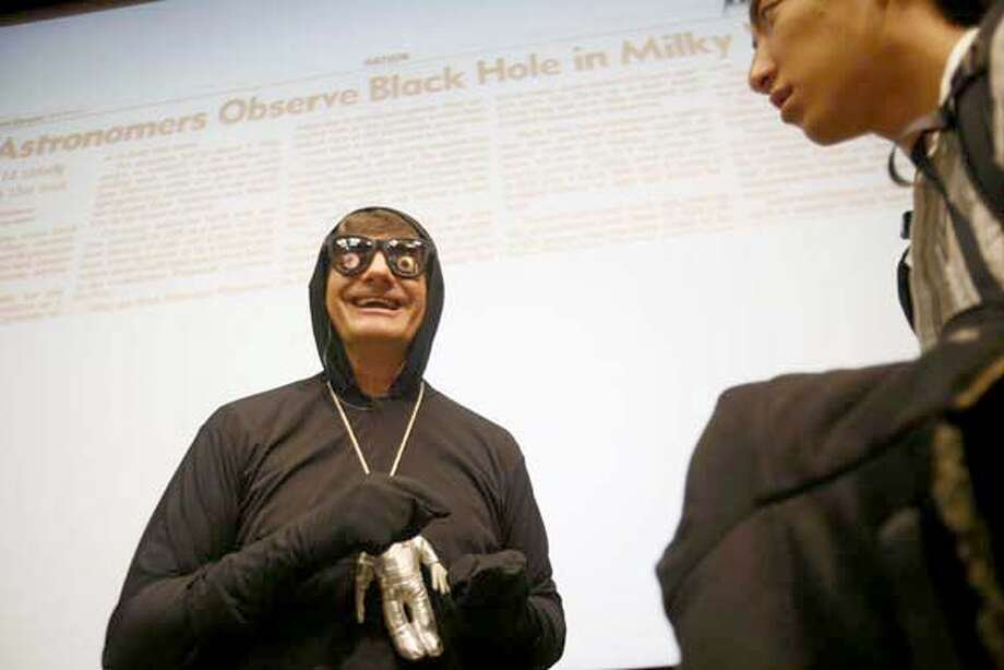 UC Berkeley astronomy professor Alex Filippenko answers questions after his Halloween day Intro to General Astronomy class at Wheeler Hall. Every Halloween, Filippenko, named �professor of the year� in 2006 by a national educational foundation, dresses as a black hole to teach his lesson on black holes. Mike Kepka / The Chronicle Photo taken on 10/31/07, in Berkeley, CA, USA Photo: Mike Kepka