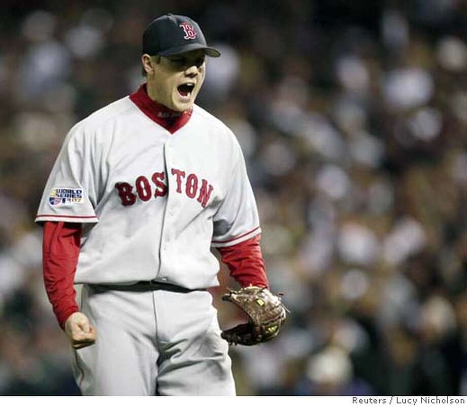 Boston Red Sox's Jonathan Papelbon celebrates getting the final out in the eighth inning against the Colorado Rockies in Game 4 of Major League Baseball's World Series in Denver, October 28, 2007. REUTERS/Lucy Nicholson (UNITED STATES) Photo: LUCY NICHOLSON