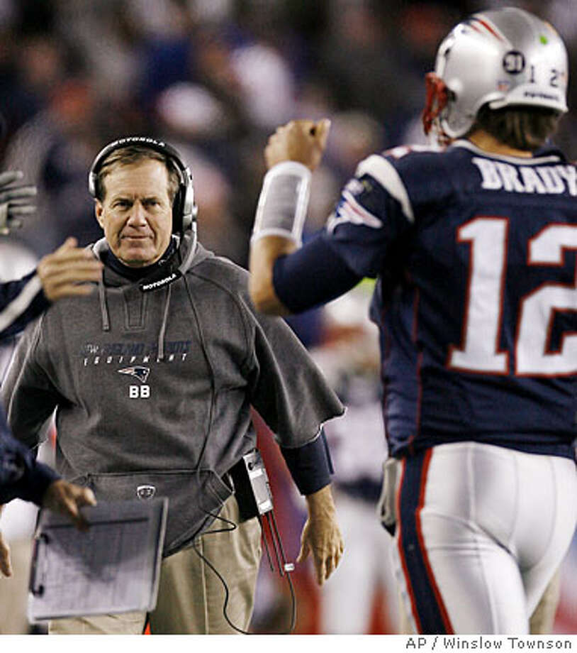 New England Patriots head coach Bill Belichick waits to congratulate quarterback Tom Brady after Brady ran for his second touchdown of the game during the third quarter of the Patriots 52-7 win over the Washington Redskins in a football game at Gillette Stadium in Foxborough, Mass. Sunday, Oct. 28, 2007. (AP Photo/Winslow Townson) Photo: Winslow Townson