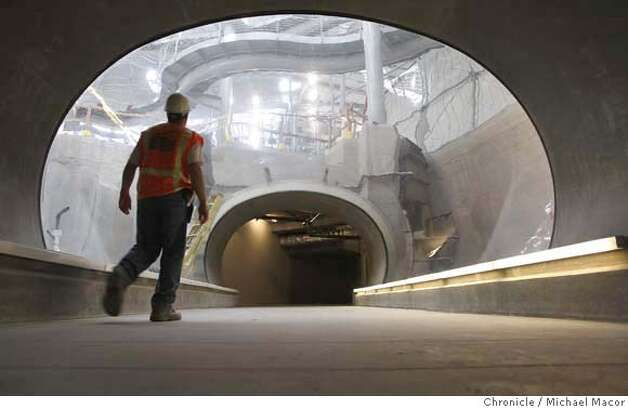 academy28_310_mac.jpg Worker, Jamie Perez, walks through a tunnel that visitors will be able to pass through and see native fish and plant life of the Amazon Rain Forrest. The basement of the 4 story tall Living Rain Forrest Dome. The new California Academy of Sciences in Golden Gate Park, well under construction begins to take shape with many interesting displays and exhibits soon to come. Michael Macor / The Chronicle Photo taken on 10/26/07, in San Francisco, CA, USA Photo: Michael Macor