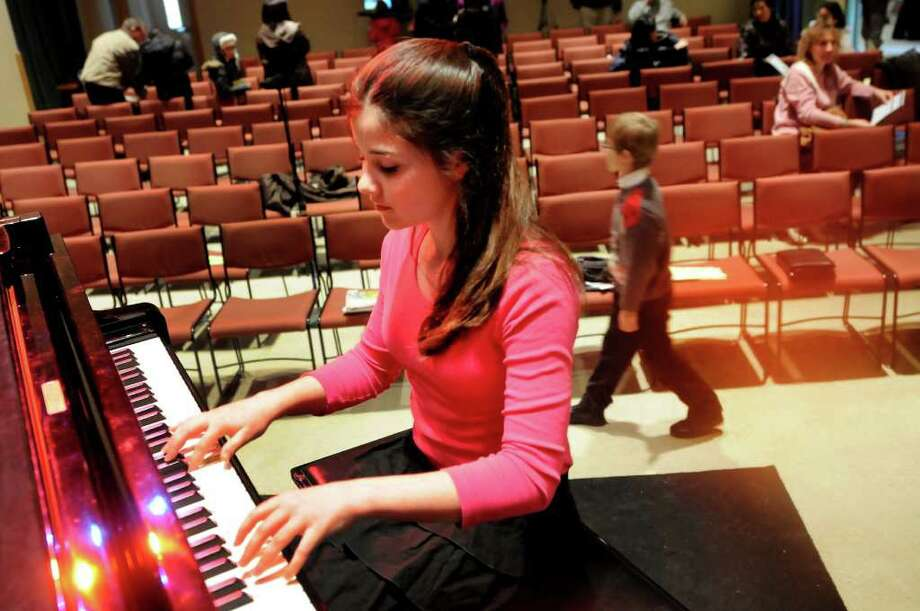 Alina Orioglu, 11, of Watervliet warms up as she prepares to perform in the Third Annual Tchaikovsky Piano Competition on Saturday, Feb. 11, 2012, at The Linda Performing Arts Studio in Albany, N.Y. The top young pianists will play Sunday at 1 p.m. (Cindy Schultz / Times Union) Photo: Cindy Schultz / 00016363A