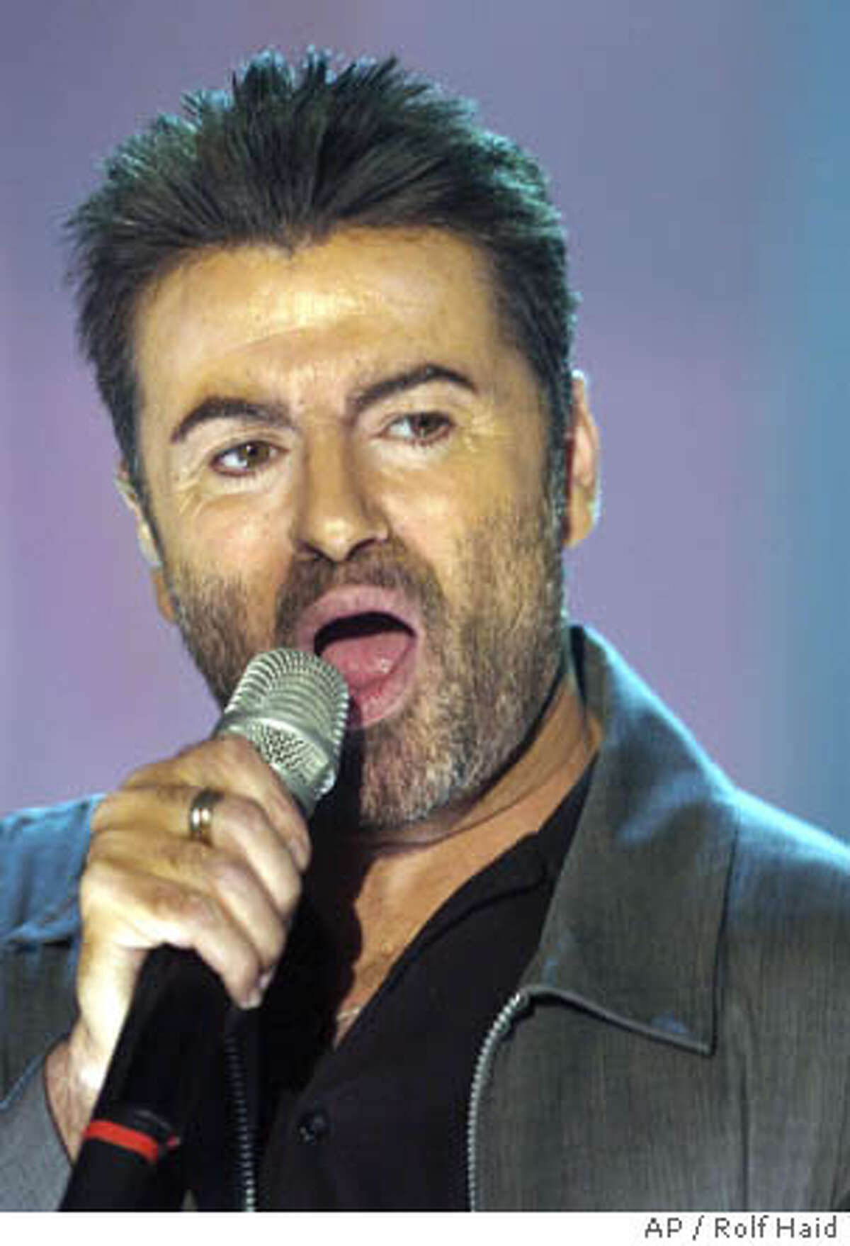 **file**British singer George Michael performs his song
