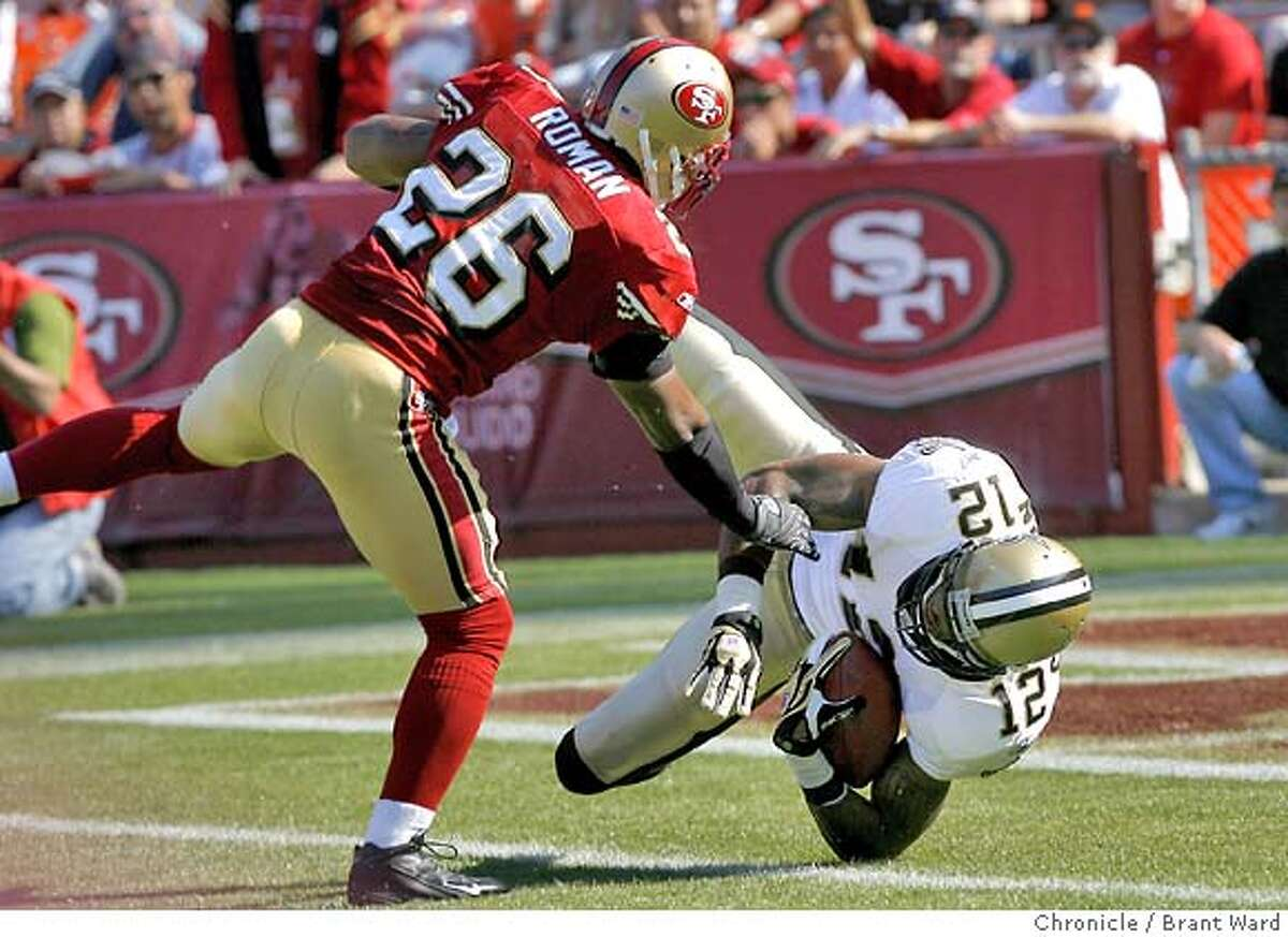 49ers_078.JPG The Saints Marques Colston went in for the first Saints TD while Mark Roman tried to defend. Game action at Monster Park between San Francisco 49ers and New Orleans Saints Sunday. {By Brant Ward/San Francisco Chronicle}10/28/07