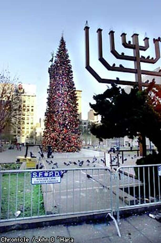 The city's Christmas tree shares Union Square with a menorah as the square is set to close for remodeling. Chronicle photo by John O'Hara