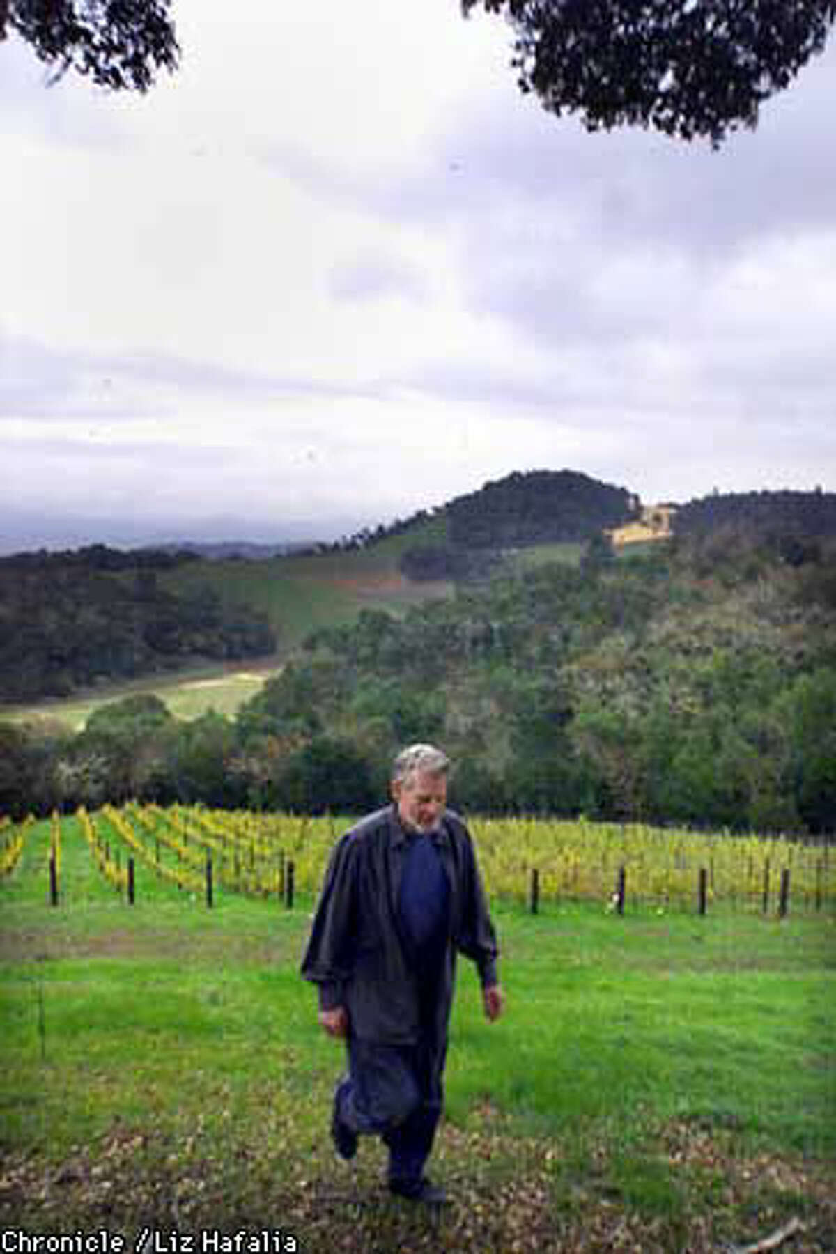 Bill Harlan walked near one of his vineyards, which produce top-of the line product. Chronicle photo by Liz Hafalia