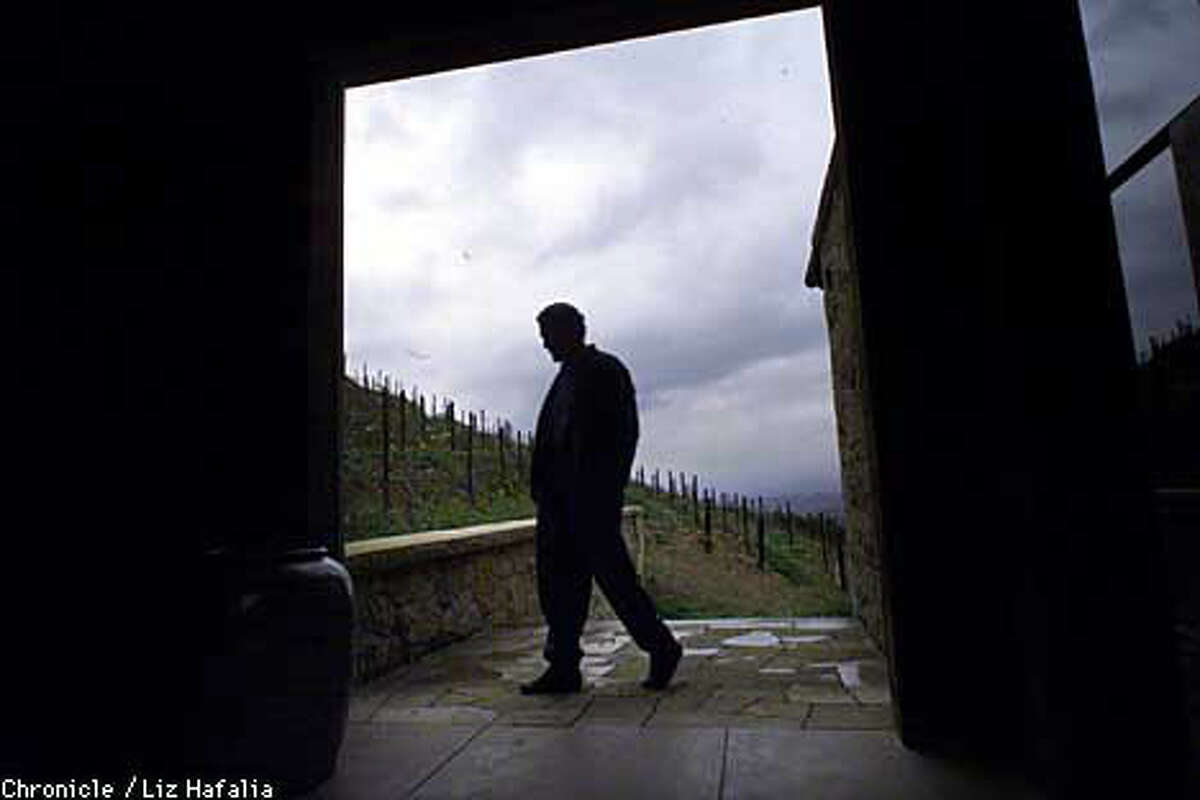 Bill Harlan surveyed one of his vineyards on a rainy day. Chronicle photo by Liz Hafalia
