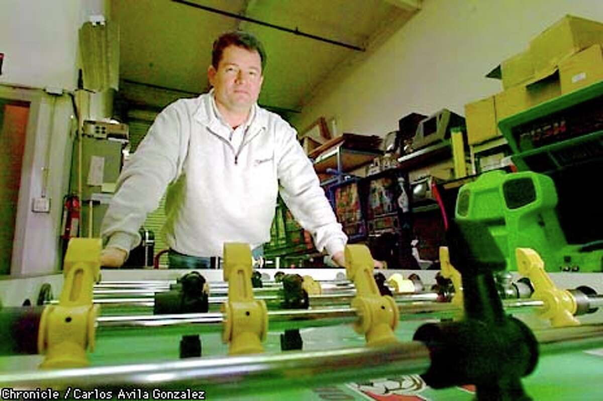 Roman Foldr, president of Video Amusement, has had to repossess foosball tables from many sinking dot-coms. Chronicle photo by Carlos Avila Gonzalez