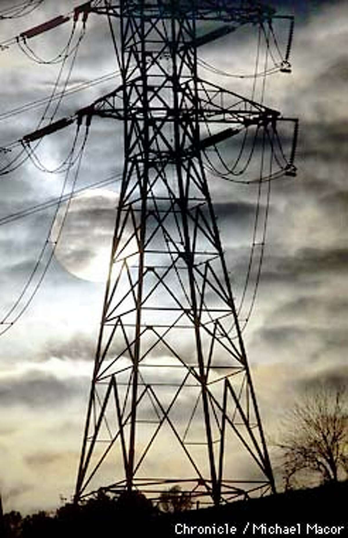 Transmission lines across California strained to stay up with demand for suddenly scarce electricity. Chronicle photo by Michael Macor
