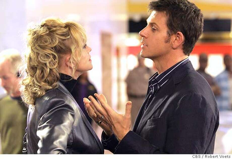 """""""Pilot"""" -- Ripley (Lloyd Owen) and Bunny Baxter (Melanie Griffith) discuss the death of Bunny's husband Buddy after his body is found at Ripley's club on, VIVA LAUGHLIN which will premiere on a special night, Thursday, Oct. 18 (10:00-11:00 PM ET/PT) on the CBS Television Network. Photo: Robert Voets/CBS Broadcasting Inc.  �2007 CBS Broadcasting Inc. All Rights Reserved. Photo: ROBERT VOETS"""