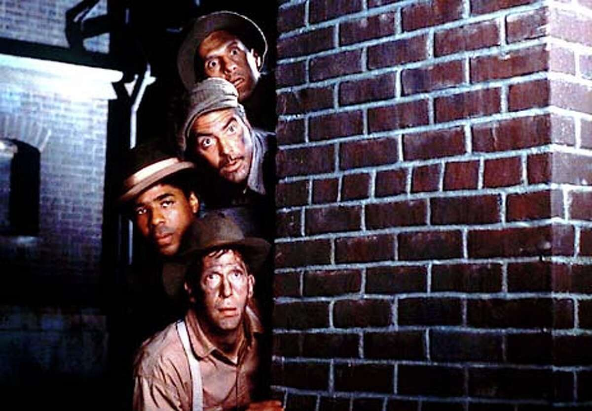 """John Turturro (from top), George Clooney, Chris Thomas King and Tim Blake Nelson star in the Depression-era musical """"O Brother, Where Art Thou?"""""""