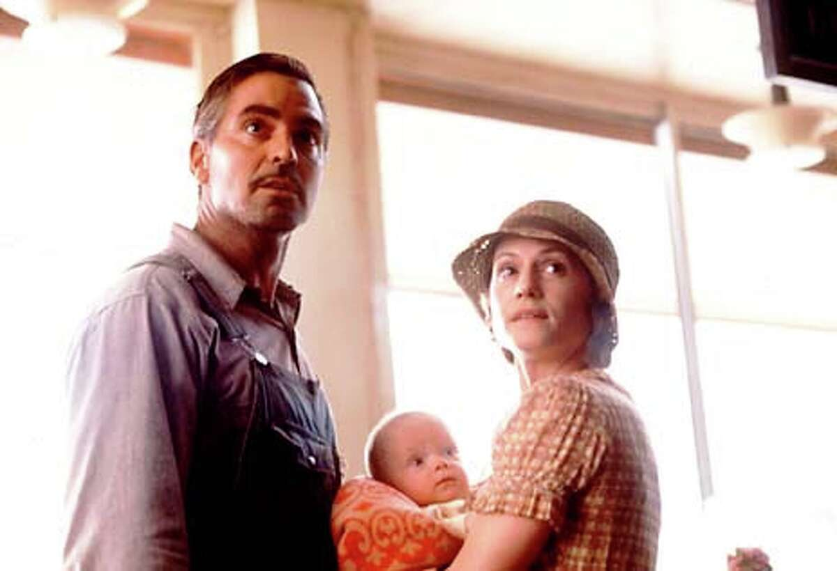 """George Clooney plays silver-tongued criminal Ulysses Everett McGill and Holly Hunter is his estranged wife, Penny, in Joel and Ethan Coen's """"O Brother, Where Art Thou?"""""""