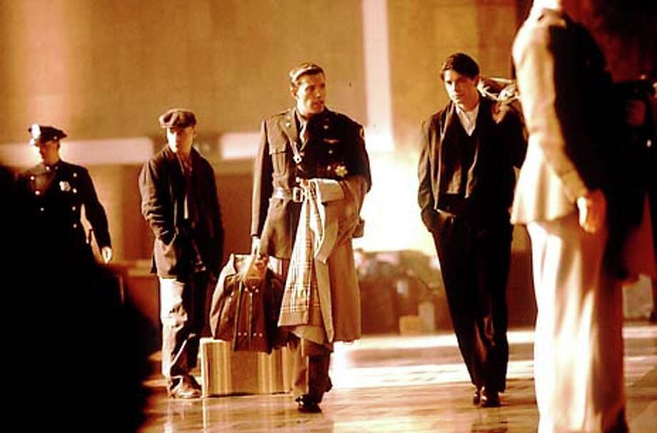 """Hoben Affleck with raincoat, center, co-stars as Rafe McCawley with Jose Hartnett, right, as Danny Walker in Touchstone Pictures/Jerry Bruckheimer Films' epic drama """"Pearl Harbor."""""""
