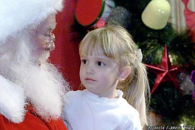 Emily Bakucz was a little nervous about her visit with Santa at Macy's in Union Square. Chronicle photo by John O'Hara