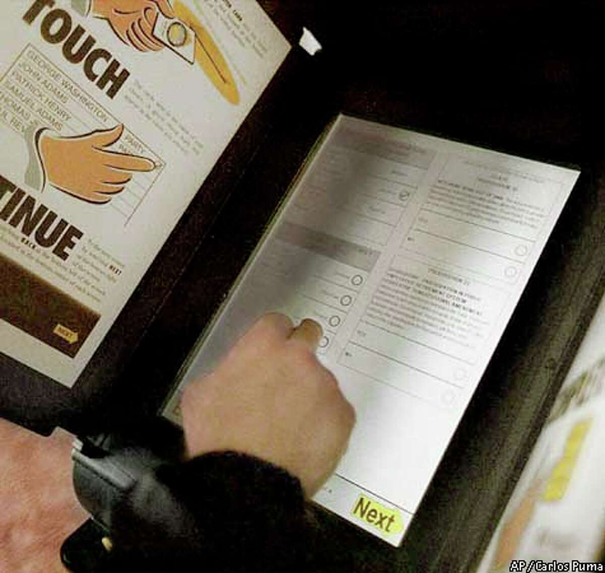 A voter used a touch screen on Nov. 7 in Riverside County, the first to convert completely to the new technology. Press-Enterprise photo by Carlos Puma via Associated Press