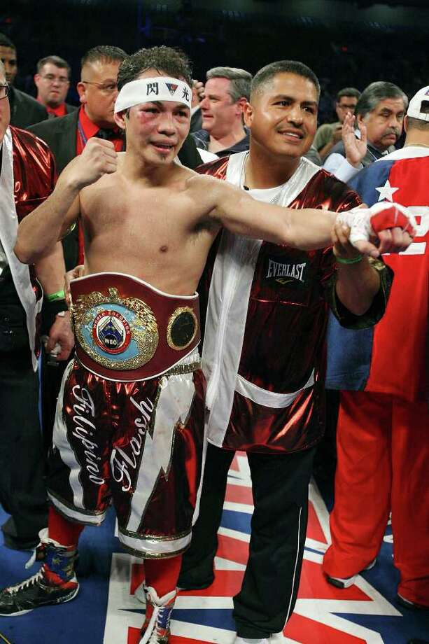 Nonito Donaire (left) poses for photos after his WBO junior featherweight title fight with Wilfredo Vazquez, Jr.  Saturday Feb. 4, 2012 at the Alamodome in San Antonio, Texas. Photo: AP