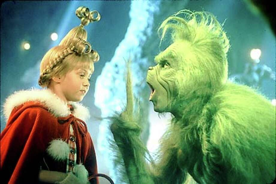 "Cindy Lou (Taylor Momsen) manages to keep smiling despite all the nasty tricks played on her by the Grinch (Jim Carrey) in ""How the Grinch Stole Christmas."""