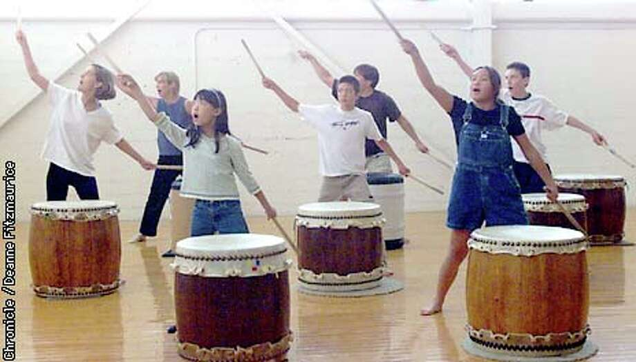 Learning to play the drums is just part of the process, as performances also use dramatic choreography. Chronicle photo by Deanne Fitzmaurice