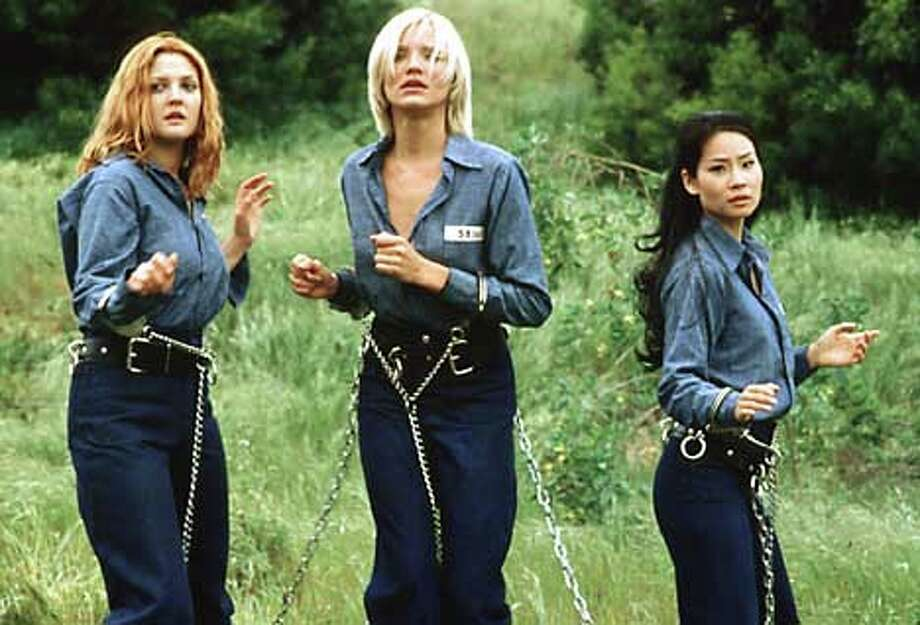 "Drew Barrymore, Cameron Diaz  and Lucy Liu (left to right) play private investigators armed with martial-arts prowess in ""Charlie's Angels.'' Publicity photo"