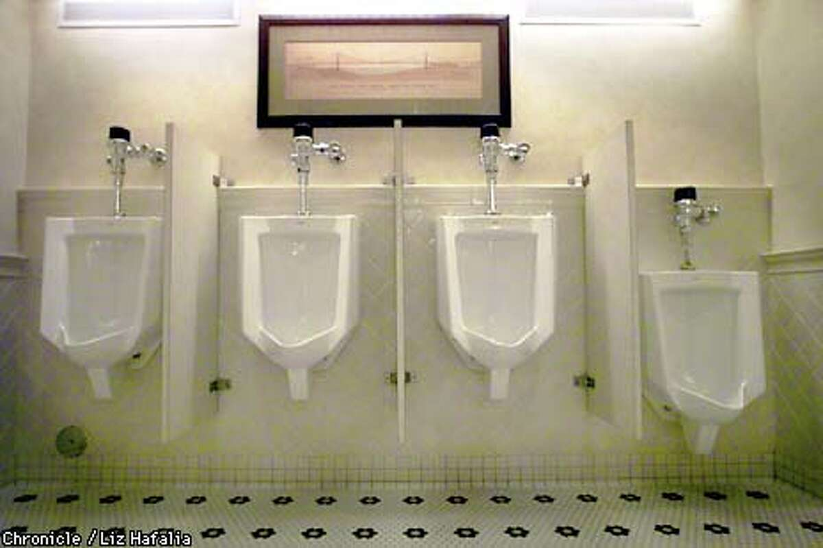 The DFS Galleria men's room features an architectural drawing of the Golden Gate Bridge. Chronicle photo by Liz Hafalia