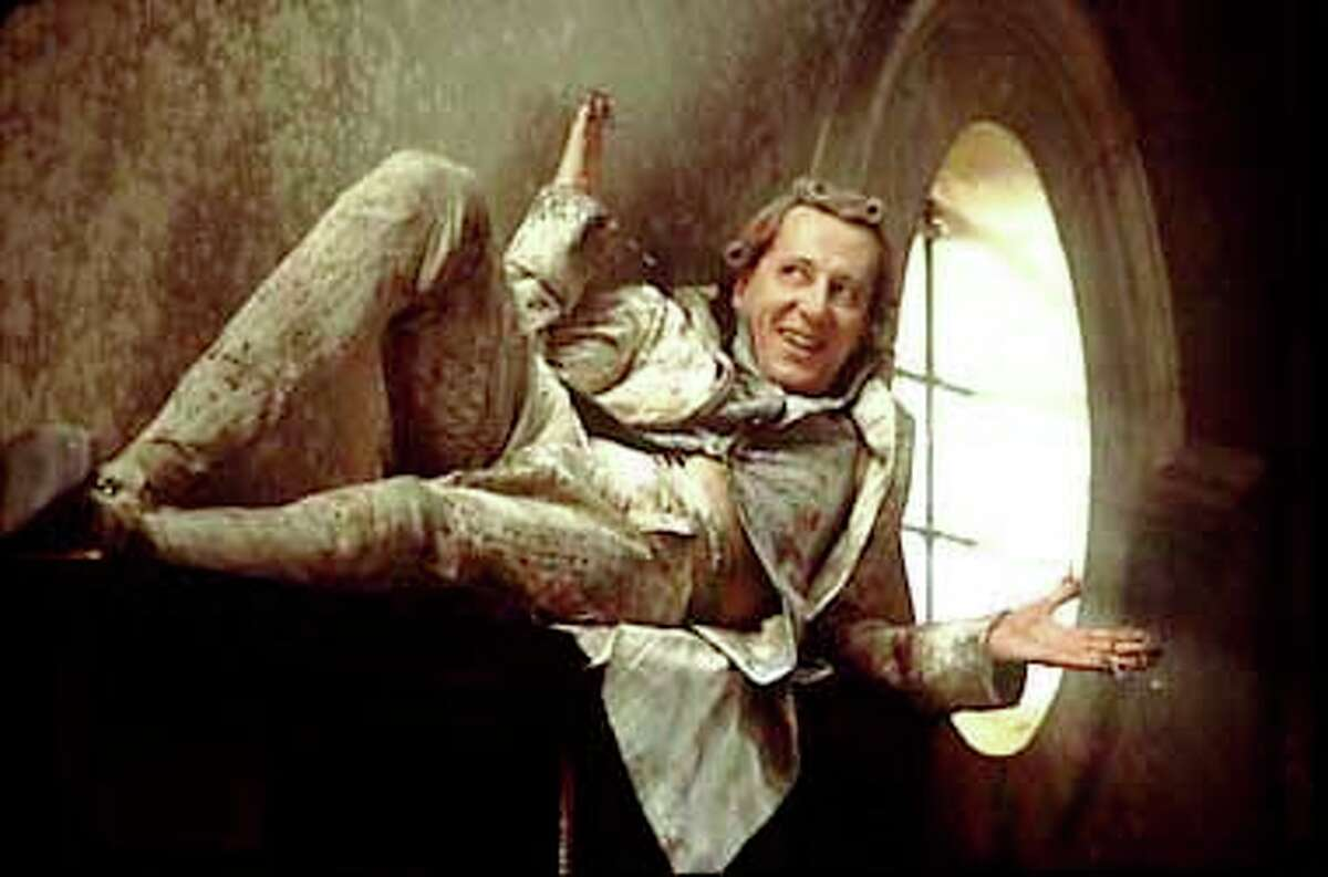 Geoffrey Rush, wearing clawlike adornments on his fingers, plays the notorious Marquis de Sade in