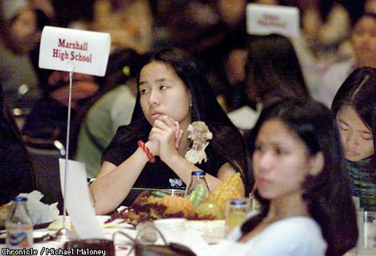 Thurgood Marshall High School students (from left) Jennifer Wong, Criselda Cua and Diana Pang listened to Yvonne Cagle's speech at the S.F. conference on young women's health. Chronicle photo by Michael Maloney