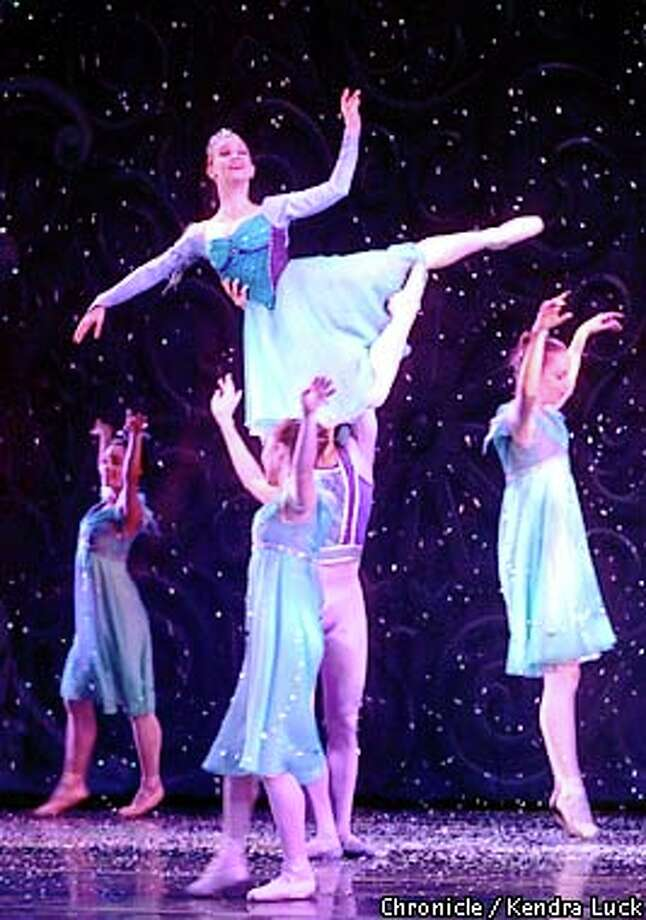 """Snow Queen Erin Yarbrough got a lift  from Snow Cavalier John Deserio in the first act of the Oakland Ballet's """"Nutcracker."""" Chronicle photo by Kendra Luck"""