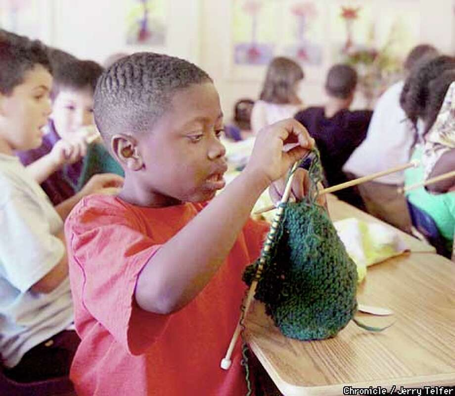 At John Moore Elementary School, handiwork is required of all students. Second-grader Eric Jackson worked on a knitting exercise. Chronicle photo by Jerry Telfer