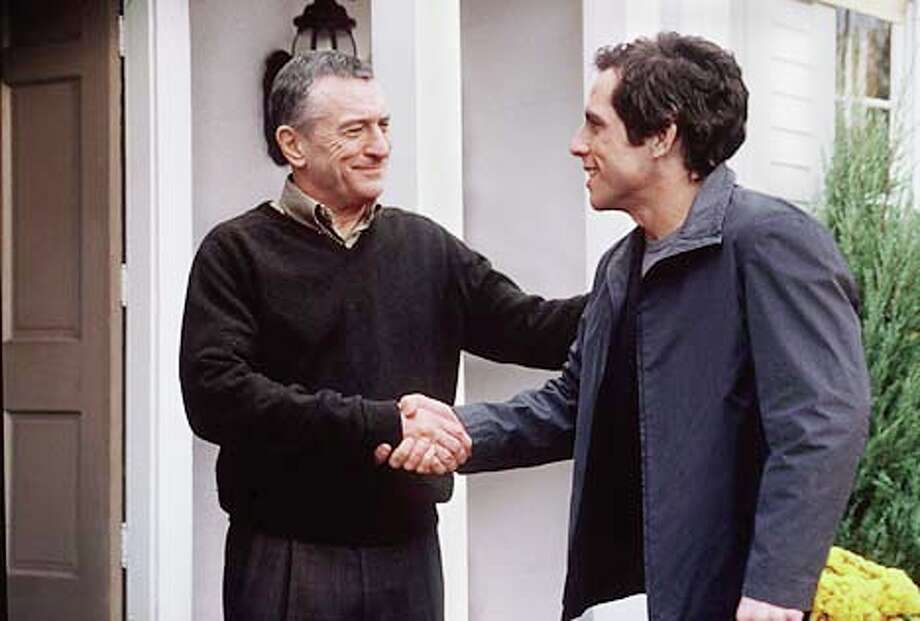 "Robert De Niro welcomes his daughter's boyfriend (Ben Stiller) in ""Meet the Parents.''"