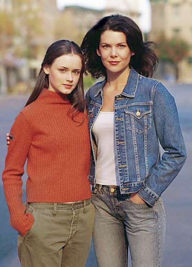 "Alexis Bledel and Lauren Graham as best-friends daughter and mom in ""Gilmore Girls,"" premiering tonight on the WB. Warner Bros. publicity photo by Frank Ockenfels"
