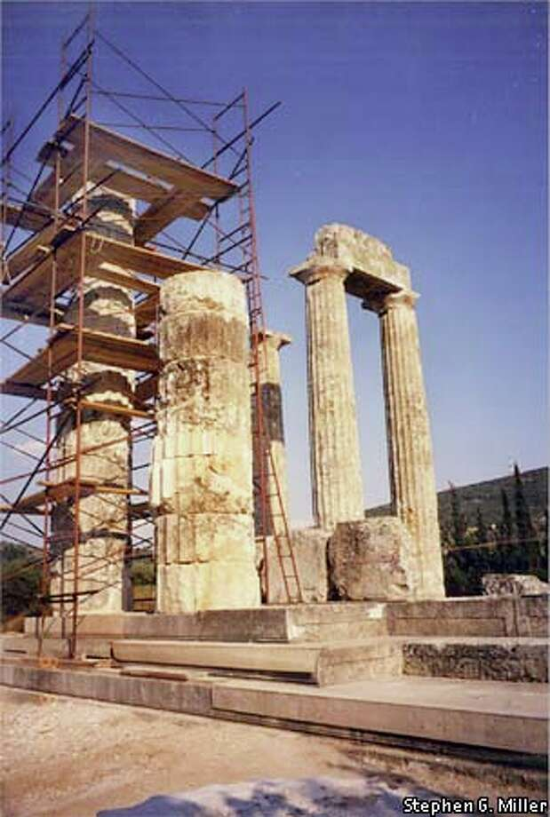Stephen G. Miller and his archaeology crews are rebuilding one of the great limestone Doric columns that once encircled the temple of Zeus at Nemea. In front of the scaffolding stands the half-column that will be completed next summer. To the right are two of the three original columns that have stood since the time of the Nemean games. Photo courtesy of Stephen G. Miller