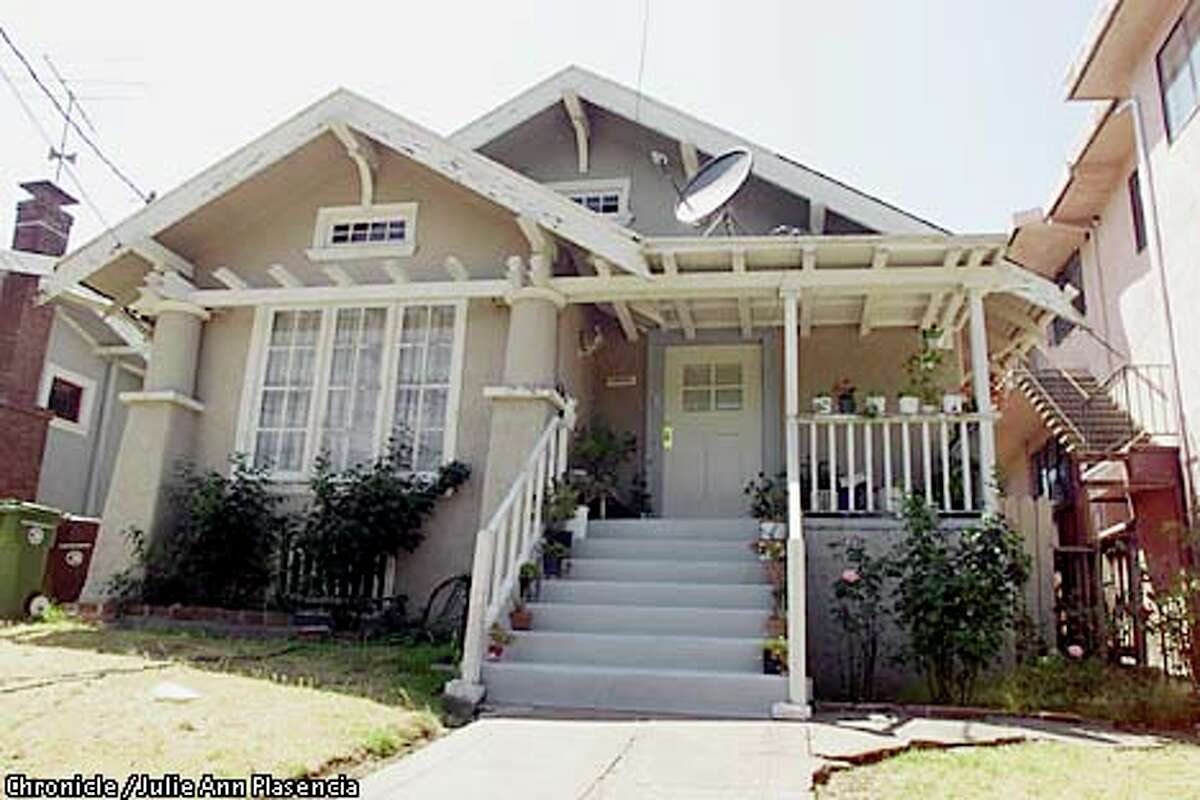 Clint Eastwood was raised in this two-bedroom bungalow in the heart of the middle-class, tree-lined Glenview district in Oakland. Chronicle photo by Julie Plasencia