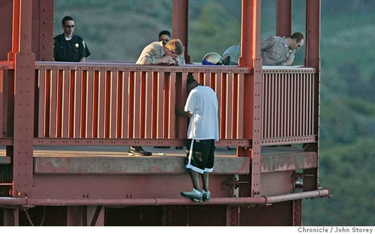 A jumper is talked down by the CHP at the north tower of the Golden Gate Bridge. John Storey San Francisco Event on 3/11/05
