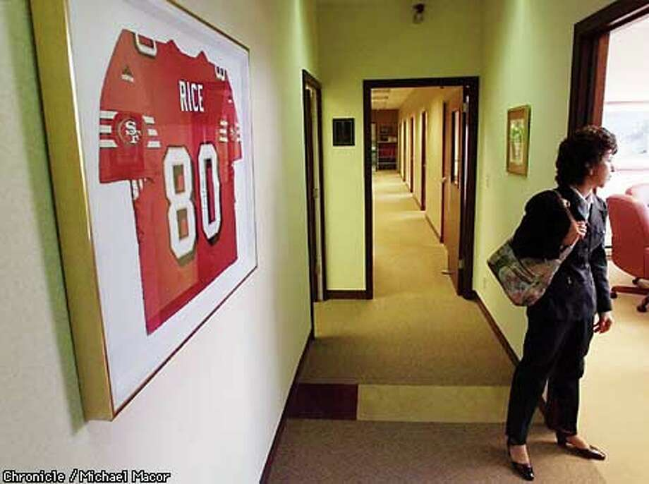 Denise DeBartolo York bought at auction the Jerry Rice jersey that hangs at DeBartolo Corp. offices in Ohio. Chronicle photo by Michael Macor