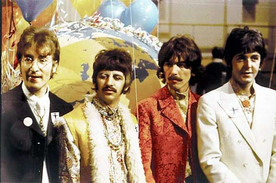 """Ringo Starr (second from left), George Harrison and Sir Paul McCartney tell their side of the story in their new coffee-table book, ``The Beatles Anthology,'' which also features excerpts from earlier interviews with the late John Lennon (left).Photo courtesy """"The Beatles Anthology''"""