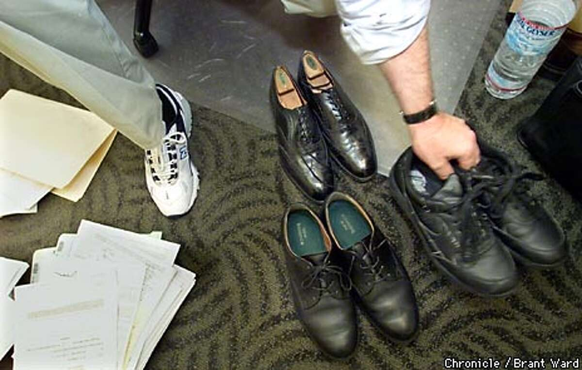 Attorney Daniel Davis of Pillsbury Madison & Sutro displayed a variety of comfortable shoes he wears at the office. Chronicle photo by Brant Ward