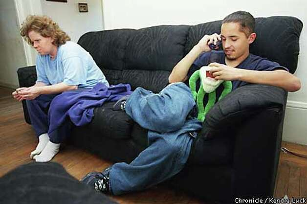 At home, Jesse talked on the phone while his mom, Deanna Drake, watched television. Drake took Jesse out of school for four months because she feared for his safety after a boy flashed a knife at him as she walked him to class. Chronicle photo by Kendra Luck
