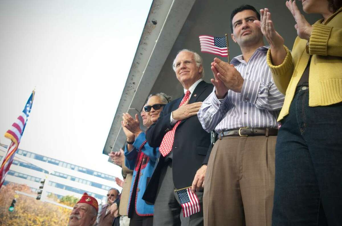 Honorary Grand Marshall, former Congressman Chris Shays, center, watches the annual Veteran's Day Parade in downtown Stamford, Conn. on Sunday, Nov. 11, 2009.