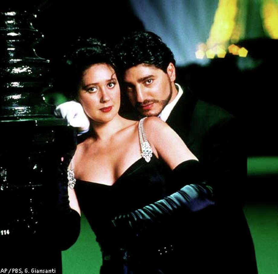 "ADVANCE FOR THURSDAY, AUG. 24--Russian soprano Eteri Gvazava and Argentine tenor Jose Cura appear in a scene from the opera ""La Traviata"" during a performance in Paris in early JUne 2000. The opera was videotaped and will premiere in the PBS Great Performances series on Sunday, Aug. 27 at 9 p.m., EDT. (AP Photo/PBS, G. Giansanti) / PBS/WNET"
