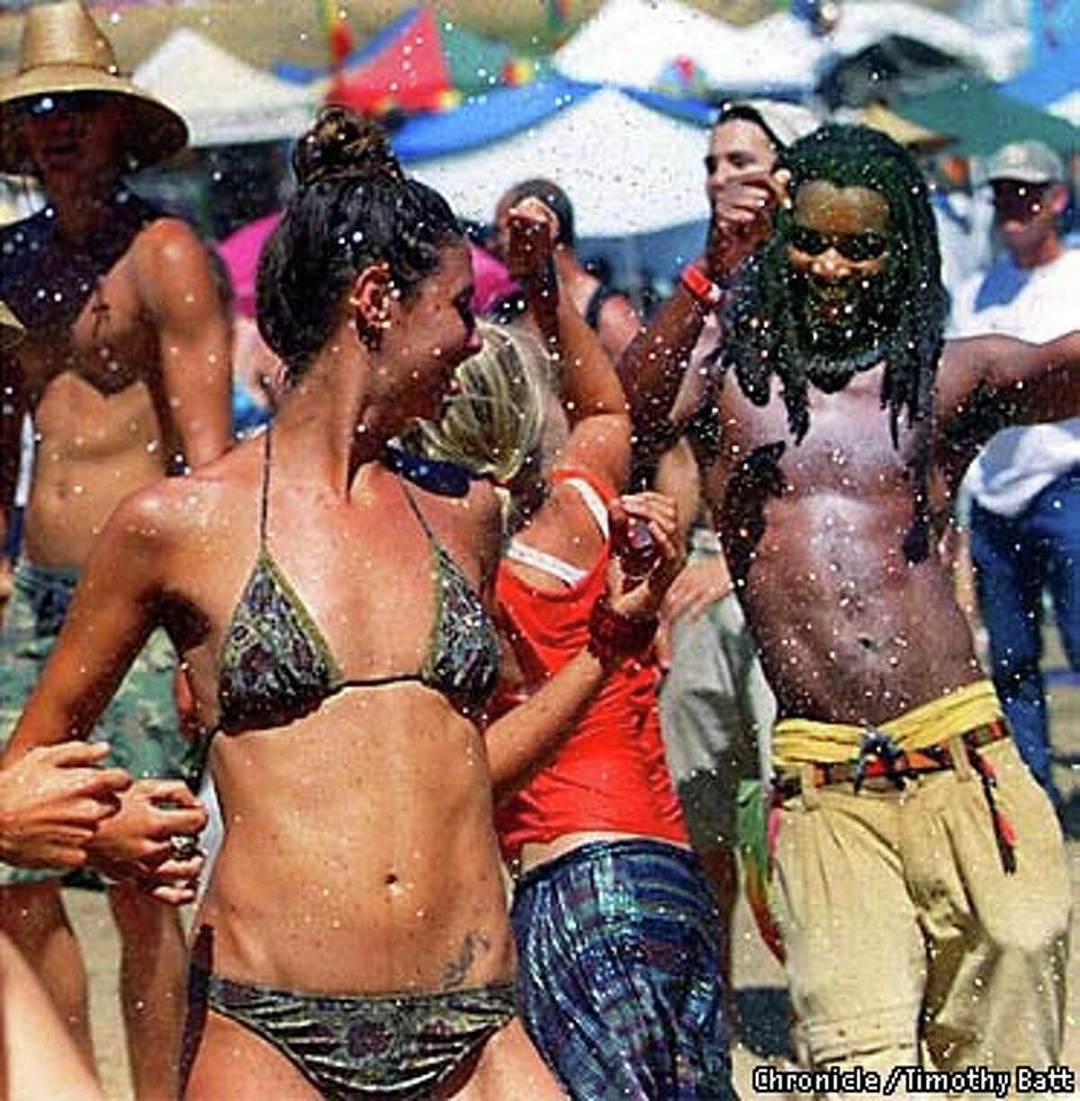 Reggae fans yielded to the beat and the heat at a past Reggae on the River Festival. Chronicle photo by Timothy Batt