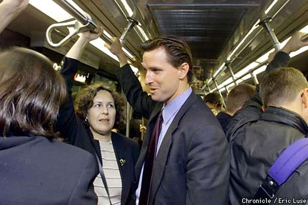 """Supervisor Gavin Newsom chatted with constituents on the Muni. """"The campaign needs some visibility, so people know I'm not ignoring them.'' Chronicle photo by Eric Luse"""