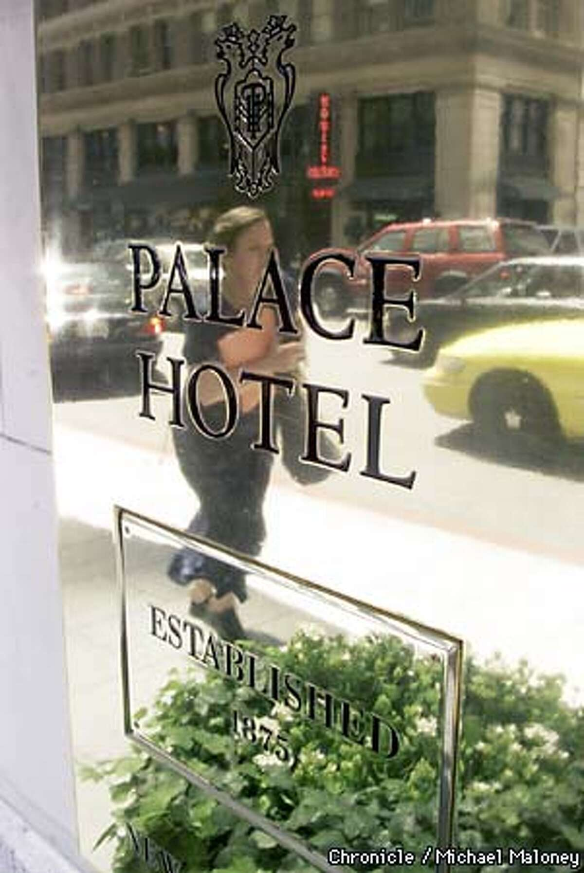 A pedestrian is reflected in a plaque outside the Palace Hotel on New Montgomery Street. The newly proposed Gold Coast Trail takes walkers by this historic hotel built in 1875. Both the Barbary Coast Trail and the Gold Rush Trail are in competition with each other to become THE historic walking route. The Board of Supes needs to endorse one or the other. CHRONICLE PHOTO BY MICHAEL MALONEY