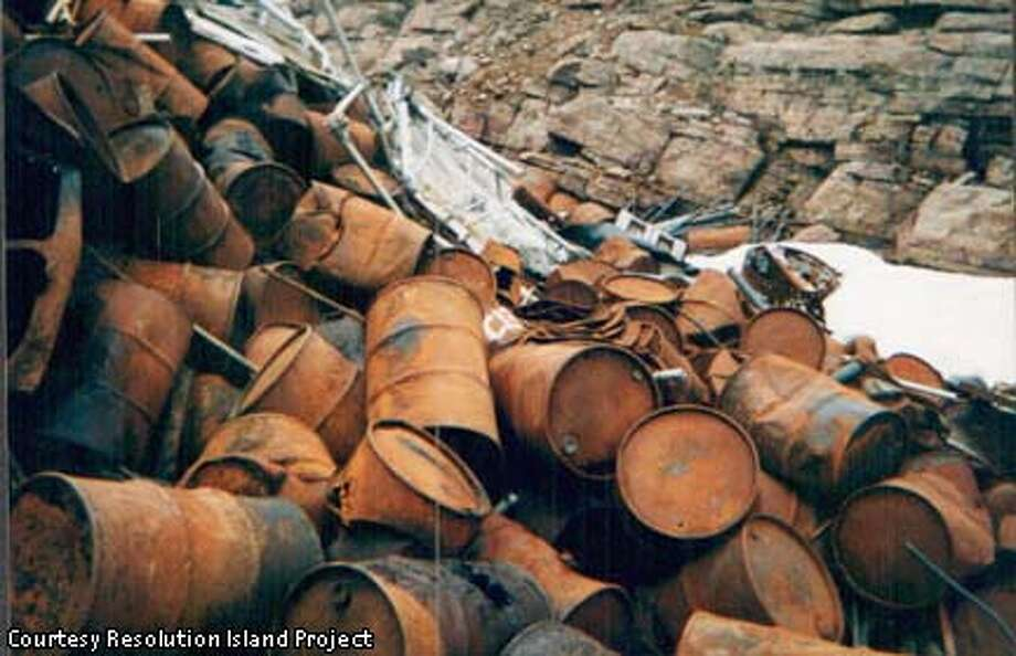 Rusted oil drums, now junked on Resolution Island in Canada, are among the debris that pose a threat to Arctic ecosystems. Photo courtesy of Resolution Island Project